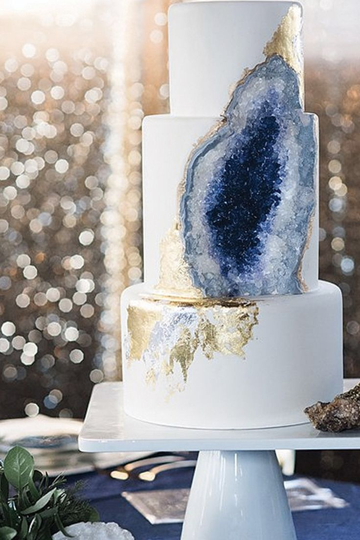 A rich, royal purple (or deep navy) plus the shine of gold leaf makes this geode wedding cake a bit more formal.