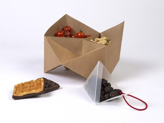 which is then folded and assembled to form a geometric lunchbox with six compartments. Flipfoodenc