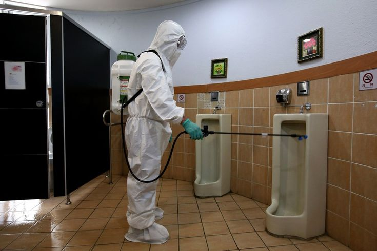 Week of Jun 6- 12, 2015 A government worker in protective gear sprays an antiseptic solution in a restroom at the Sowol Art Hall in Seoul on Friday to help fight a Middle East respiratory syndrome outbreak, which has killed at least 10 people in South Korea. SEONGJOON CHO/BLOOMBERG NEWS