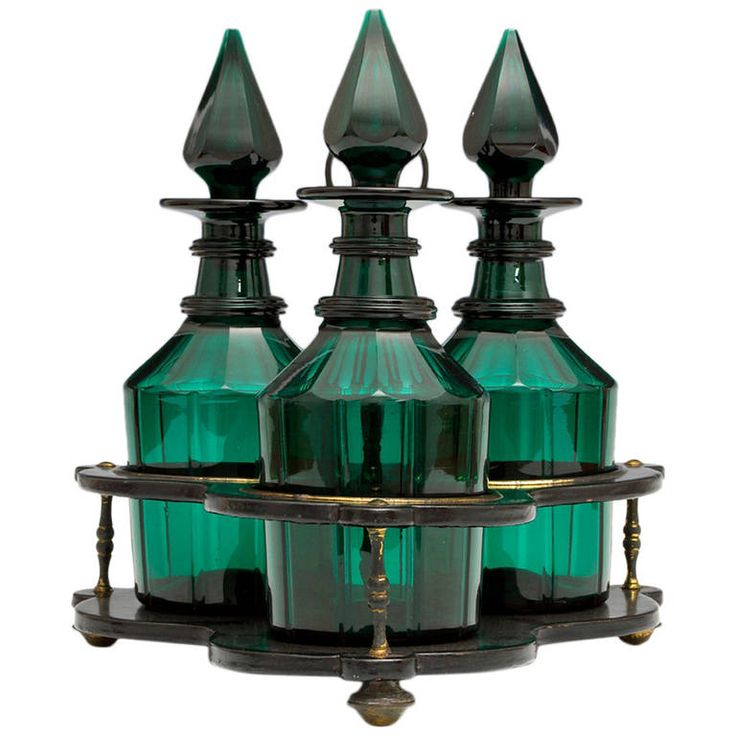 Set of Three Green Glass Victorian Decanters in Black Lacquer Stand   From a unique collection of antique and modern barware at https://www.1stdibs.com/furniture/dining-entertaining/barware/