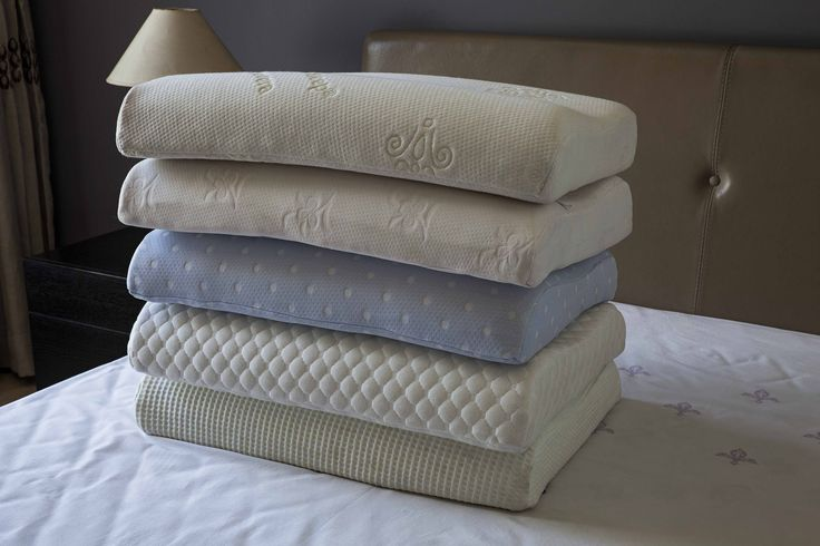 assorted pillows with various covers in a Contour shape...