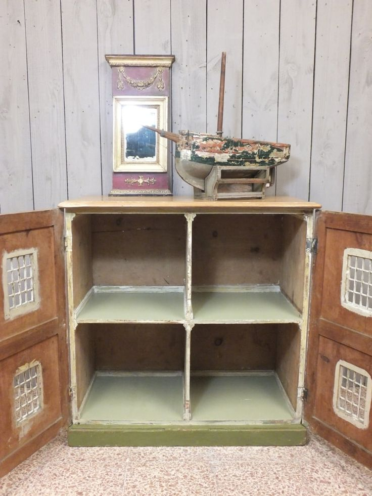Doll's house A rare and wonderful find. A superb early 19th century dolls house of cupboard form. The outside with original brick paintwork opens to reveal four large pigeon-hole shelves with later...
