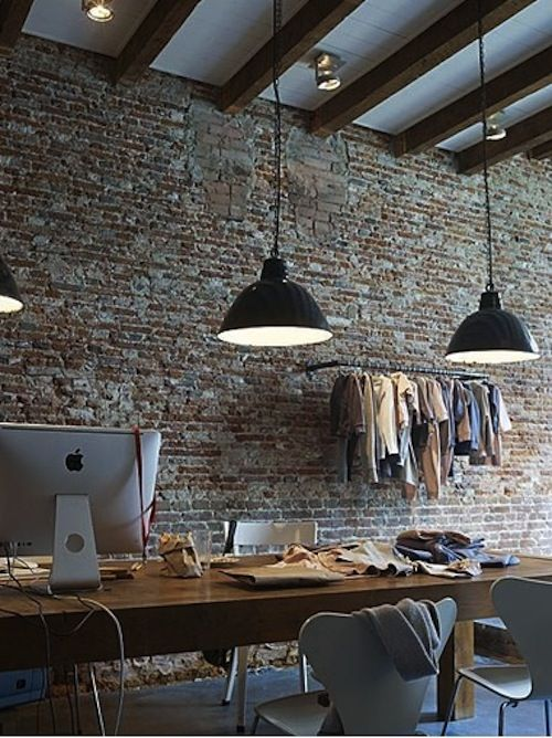 exposed brick, industrial style pendants, wood table, modern chairs -- great combination.