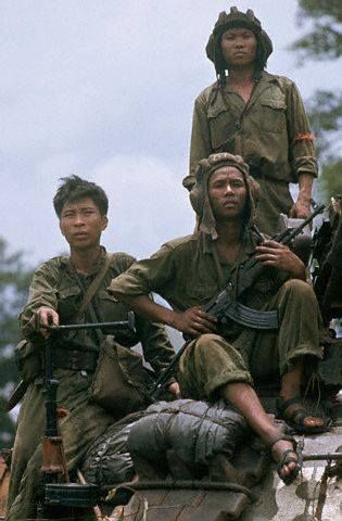 North Vietnamese Army infantrymen. The machine gunner armed with an RPD appears to be wearing a U.S. M56 pistol belt (vertical weave) with a M67 20rnd magazine pouch attached to it, in addition to his RPD ammunition bag. One of the tankers also carries a Type 56 assault rifle with a folding stock.