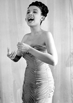 Lena Horne.  At age 16, Horne dropped out of school and began performing at the Cotton Club in Harlem. A few years later Horne joined Noble Sissle's Orchestra, and later toured with bandleader Charlie Barnet in 1940–41.  She went to Hollywood and appeared in a number of MGM musicals, most notably Cabin in the Sky, (1943.)  Blacklisted during the McCarthy era, she left Hollywood and established herself as one of the premiere nightclub performers of the post-war era.