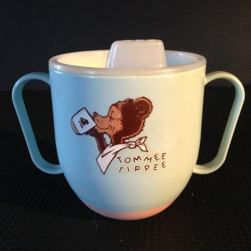 Tommee Tippee baby cup. MY LITTLE BROTHER USED ONE OF THESE. I WAS 13 YRS OLD WHEN HE WAS BORN, SO I HAD A LOT TO DO WITH THE FILLING, RE-FILLING, WASHING AND DRYING OF HIS LITTLE CUP. HIS WAS YELLOW.