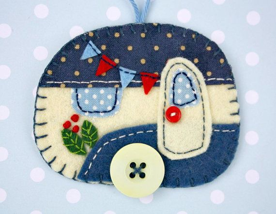 Felt trailer Christmas ornament. Vintage caravan trailer hanging ornament, handmade from felt and decorated with fabric scraps. With tiny felt bunting and buttons for the wheel and door knob. Available in vintage blue and cream, or vintage red and cream. Blanket stitched edges and a cotton loop for hanging. The ornament is flat in shape, with a plain felt back. Size approx 3 x 2.5 inches / 7.5 x 6.5 cm A perfect finishing touch for a little caravan, or the Christmas tree. You can see more...