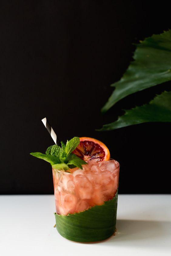 Blood orange cocktail:  2 oz aged Jamaican dark rum  1/4 oz orange curacao  1 1/4 oz fresh lime juice  3/4  oz fresh blood orange juice 1/2 oz orgeat  blood orange slice, garnish  mint, garnish
