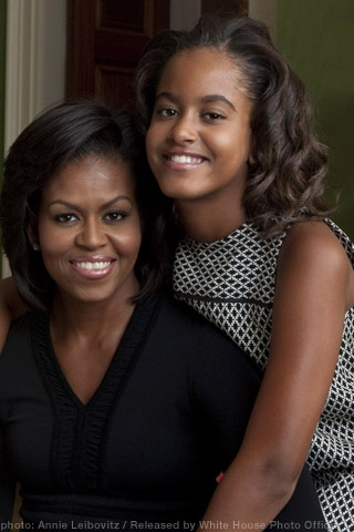 First Lady Michelle Obama and her oldest daughter Malia Obama.