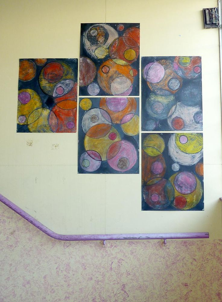 Collaborative artwork to pretty up ugly stairwell. 3 - 4 students worked on each piece: colouring circles with warm-coloured oil pastels. Painted over with black ink. Years 1 and 2