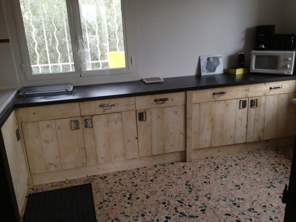 Kitchen cabinets, made from pallets, that actually look good.