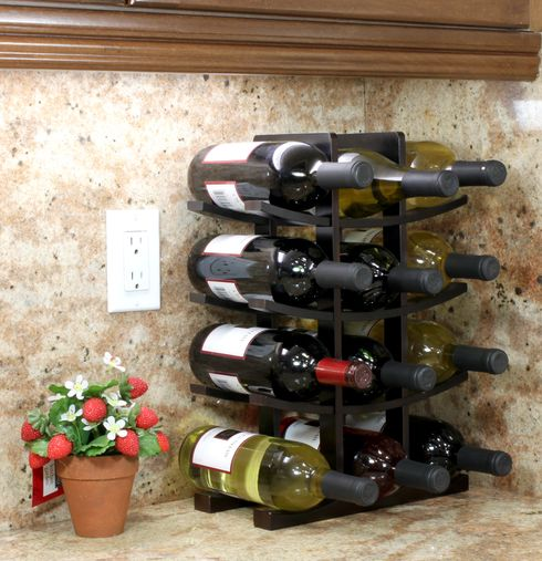 Made with 100% eco-friendly bamboo, the 12-Bottle Bamboo Wine Rack from Oceanstar Design Collection is the ideal fit for wine enthusiasts or starters beginning their wine collection. Present this wine