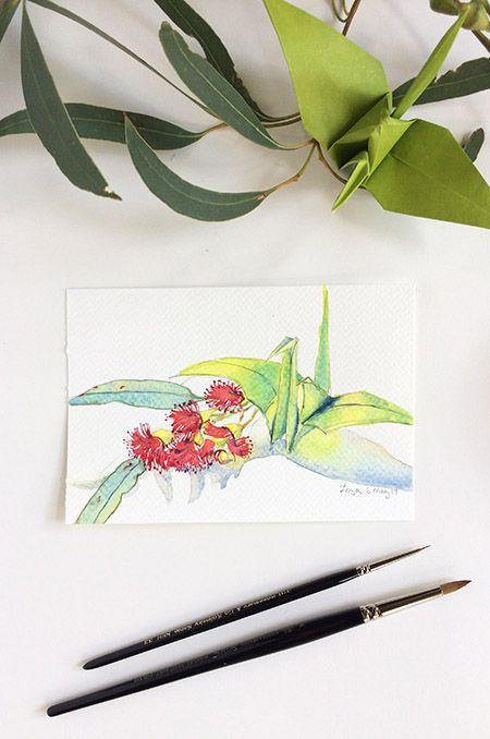 Winsor & Newton watercolours on Daler-Rowney Aquafine watercolour postcardOrigami crane painting No. 18 with eucalyptus blossoms by Zoya Makarova