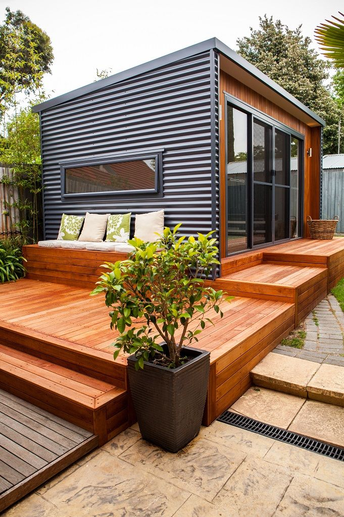Great tiny house look. Beautiful deck and patio as well- I like the horizontal metal and wood.