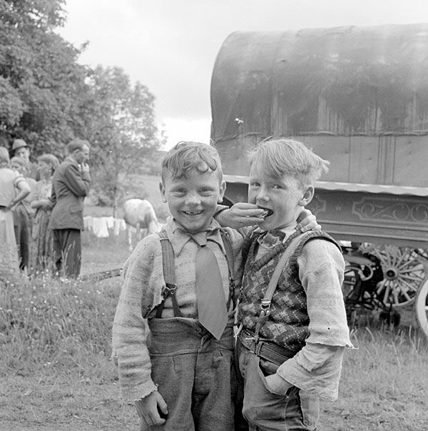 Sheridan/O'Brien Camp, Loughrea Date: May 1954 These two boys are from the travelling community. They are pictured at the family site in Galway in front of a traditional caravan.