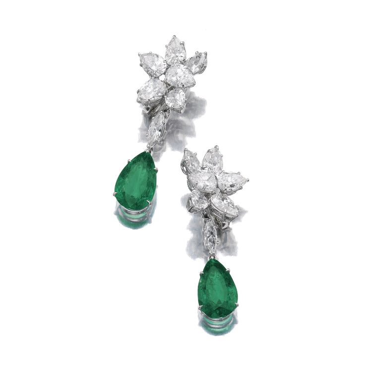 PAIR OF EMERALD AND DIAMOND PENDENT EAR CLIPS, HARRY WINSTON Each cluster surmount set with pear-shaped diamonds, suspending a detachable pear-shaped emerald drop, maker's mark.