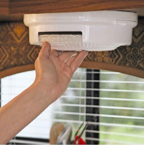 Get a ceiling mounted paper plate dispenser. 44 Cheap And Easy Ways To Organize Your RV/Camper