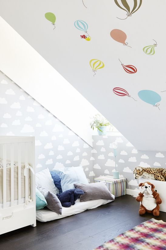 We love designs that use the interesting architecture in attics to create a beautiful room. Like the balloons in this attic nursery!