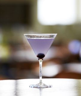 In a martini shaker filled with ice, add ingredients and shake vigorously. Dispense into a chilled martini glass and add a frozen grape for garnish. Recipe courtesy of Torani Facebook Fan- Lynn B.