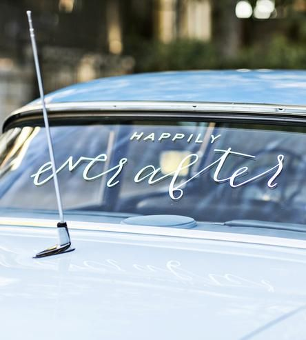"""Unlike spray paint, this getaway car sign is built to last. And by built, we mean cut. For each wedding sign is cut by hand, in a hand-lettered design that reads: """"Happily Ever After"""". And because it's not paint, you can even save it afterward, if you'd like."""