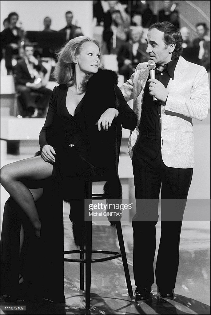 Tv 'Numero 1': C.Aznavour, U.Andress And S.Vartan: Charles Aznavour With Ursula Andress In France On February 21, 1976