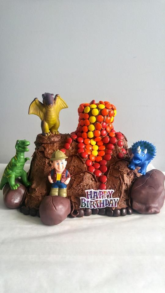 I don't usually incorporate toys in to my cakes but I couldn't be happier with how this brownie and m&m dinosaur volcano turned out. #baking #cooking #food #recipes #cake #desserts #win #cookies #recipe #cakes #cupcakes