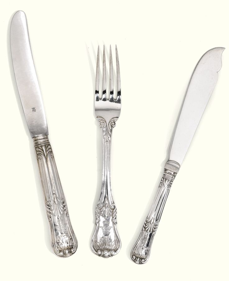 German Imperial table silver, the majority E Deppe, retailed by Gebr. Friedländer, Berlin, 1898/99 and circa  with foliate terminals and cypher of Wilhelm II German emperor comprising: 12 table knives with WMF stainless steel blades, 12 table forks and 6 fish knives, the fish knives with silver blades stamped H.Wilm Berlin and royal cyphers WA, majority with stamped dates 1896/97/98/1899  1730gr, 55oz 12dwt all in excluding table knives