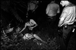 USA. New York City. 1979. The call coming through the police radio said a woman was seen being dragged, screaming, into an overgrown lot. She was found... battered, drugged and unconscious. Though she was known along the street as an addict and a prostitute, all the other pimps and whores said they hadn't seen a thing. The girl later said she hadn't either.