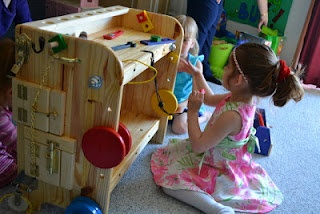 The Active Toddler: Activity Work Bench.  Combo tool bench and activity board.  Lots of switches, latches, and various doohickeys to keep the littles busy