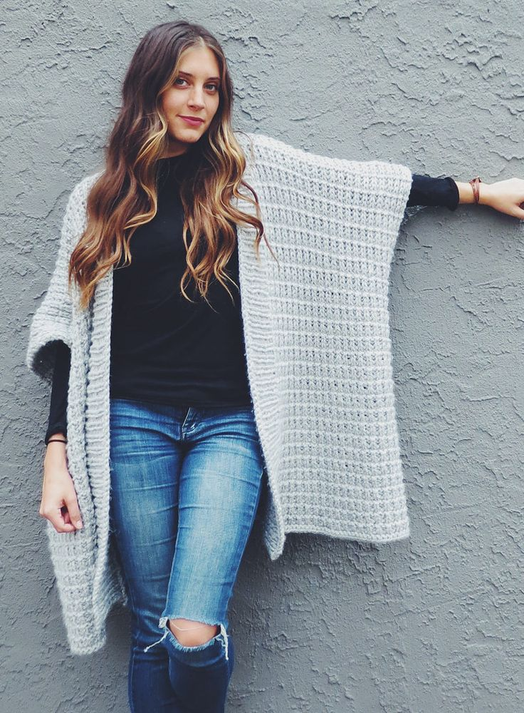 Free Knitting Pattern for Cloaked in Clouds Poncho - Alexandra Tavel's easy cardigan sweater was inspired by blanket ruanas and features a wide rib collar and a thermal stitch for warmth. Quick project in bulky yarn, it is rated easy by the designer and Ravelrers.