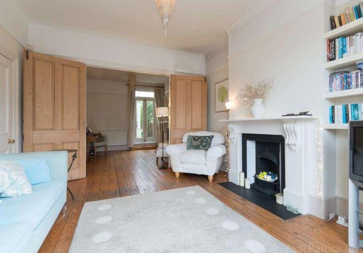 Wooden double doors, bookshelves, victorian terrace