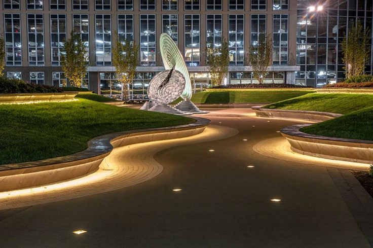 Adjacent to the National Geospatial Intelligence Agency, in Springfield, VA, Receptor is a site specific landscape sculpture comprised of earthworks and a br...