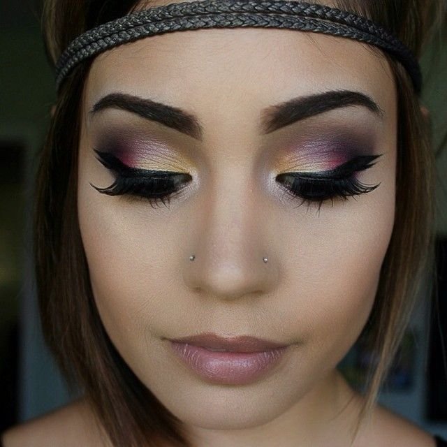 A blend of Gold and purple shimmer Eye makeup