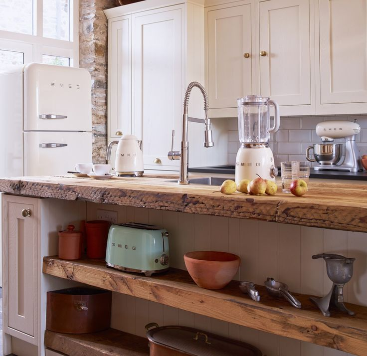 These accessories from Smeg look very much at home in a traditional style kitchen. #kitchen #accessories #toaster #kettle #blender #fridge #traditional #stand mixer