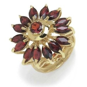 Gioie  Gioie Ladies' Ring in Yellow 18-karat Gold with Garnet, form Flower  Be the first to review this item  Price: $2,278.30 - $2,746.95  Sale: Lower price available on select options
