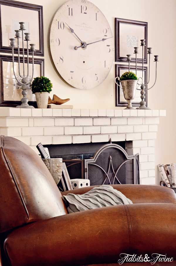 Comfortable family room - love the white brick fireplace eclecticallyvintage.com