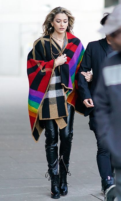 20fe09ecc0d Michael Jackson s daughter and LFW guest Paris Jackson wrapped up in a  multicolor cape and zipped leather trousers.