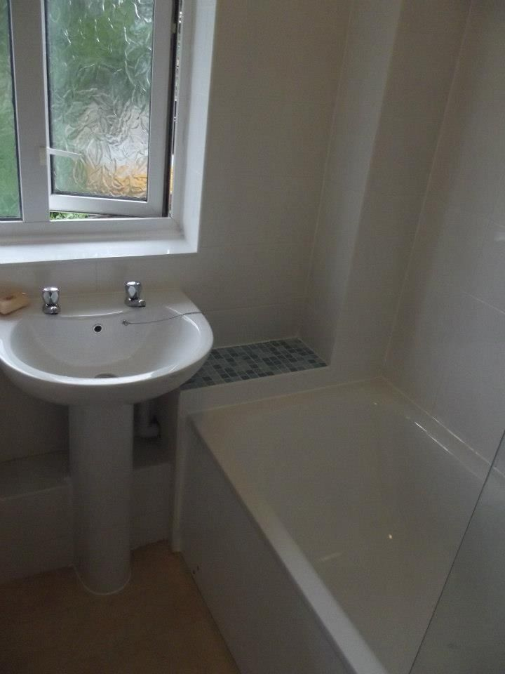 The surplus mosaic tiles were used to top the boxing in section at the end of the bath and help spread the colour out.