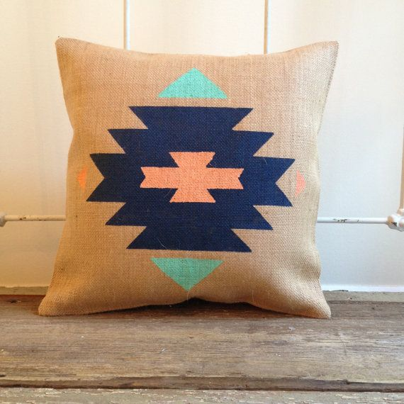 We love this hand painted aztec pattern on our burlap pillows. Perfect for mixing patterns and accent decor in any room! The Aztec/tribal patterns are very on trend and bring in a bold pop of color and natural design element. Pattern is on front side of pillow only. Choose three colors from our color chart < ** Specify color selections in notes to seller when placing your order ** >  Removable pillow cover measures 15 x 15 square, envelope style, INSERT INCLUDED…