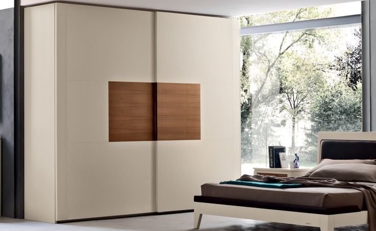 Agrifoglio - Melograno   Contemporary Collections Le Fablier   2 sliding doors wardrobe   Measures in cm (LxDxH) 295x67x250   Structure in ash wood, doors with panels in canaletto walnut, ash wood, mirror or special glasses   Standard equipment: 1 chest of drawers - 2 large shelves - 3 clothes hangers