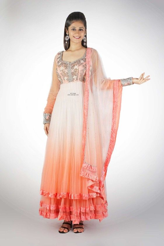 Buy Ombre Neon Pink Coral Anarkali Online - AD Singh Ombre dyed Floor Length Anarkali in a neon pink and coral color with a deep scoop back and chudidar style sheer fitted cuff sleeves. The entire Ombre Neon Pink Coral Anarkali is made in soft tulle nett with intricate crystal embroidery. The outfit comes with a matching stole and a stretch fit lycra chudidar.