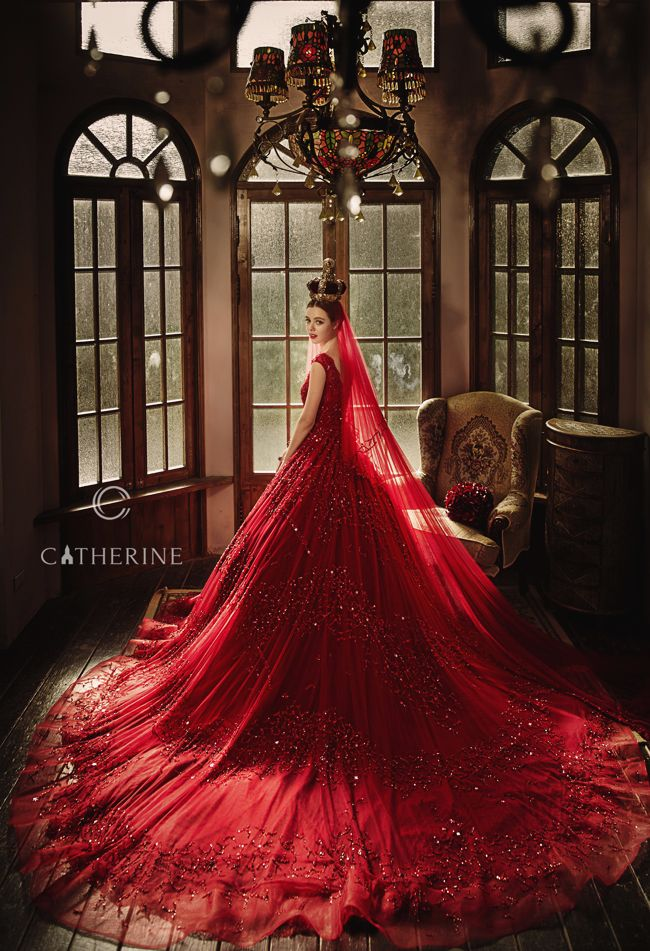 Blending classic and luxury,  this timelessly sophisticated red gown from Catherine Wedding is a show stopper!