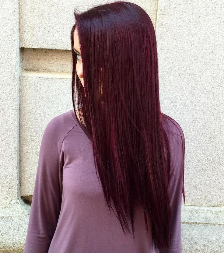 Long, slick amethyst-colored hair is the stuff of dreams. Make it a reality by dying those long locks a crimson purple hue and letting them just hang down naturally. No muss, no fuss.
