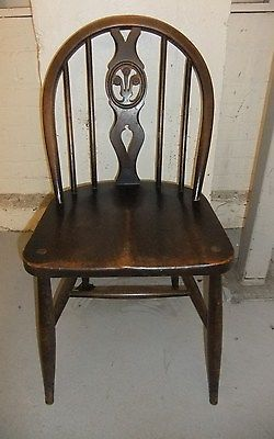 Vintage Ercol Spindle Back Dining Chair with Fleur de Lys Design on back