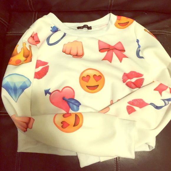 Emoji crop top This emoji crop top is very comfy, and perfect to wear with an under shirt or just by its self. This crop top consists of pretty much the same emojis in the front and back. Elfin Tops Crop Tops