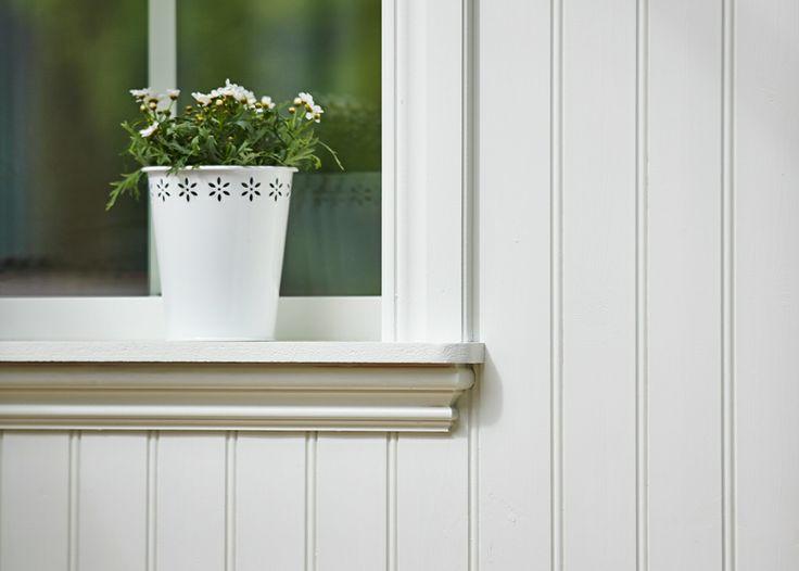 Trivselhus - Pärlspont och vacker omfattning runt fönster