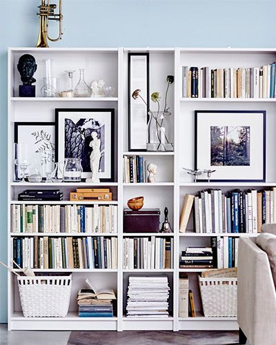 Learn how to turn your basic bookcase into an eye-catching display with these tips and tricks.