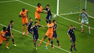 Yaya Toure of the Ivory Coast and Yuya Osako of Japan go up for a header