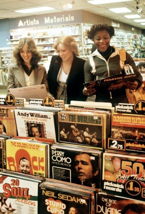 Browsing the record department.....those were the days. In 30 years time, who will fondly remember when they used to download albums on their phone?