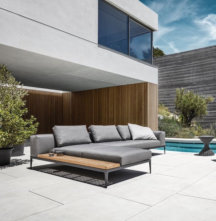 Grid is a high quality outdoor sofa with powder coated aluminium frames, water-safe nautical cushion technology and teak table tops.